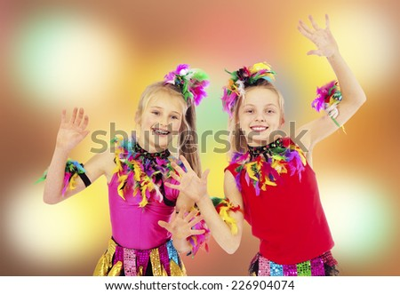 Two of happy children dancing at the carnival - stock photo