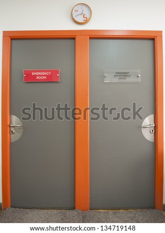 Two office doors in a medical hospital center to emergency room and management - stock photo