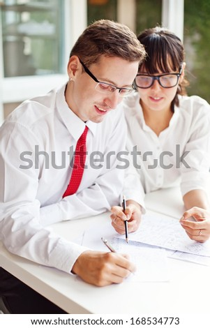 two office workers creating together