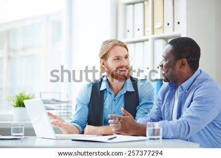 Two office workers talking - stock photo