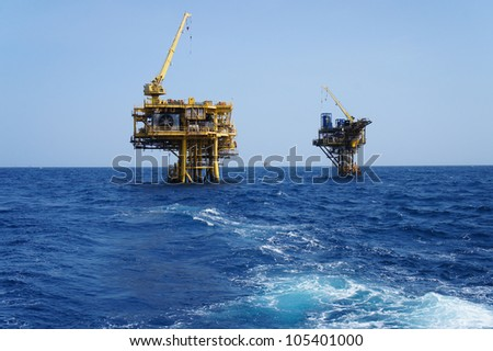 Two Offshore Production Platforms For Oil and Gas Development - stock photo