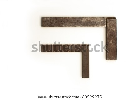 Two old and rusty carpenters squares on white background - stock photo