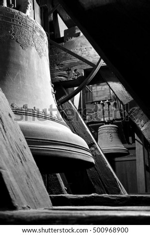 Two old bells between the joists in the historical tower.