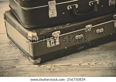 Two old blue suitcases on the wooden vintage floor - stock photo