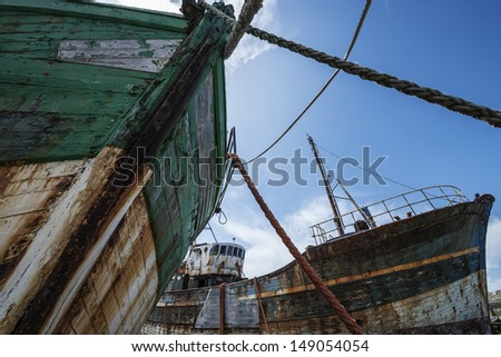 two old fishing boats - wrecks in detail - stock photo