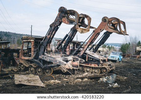 two old forestry machinery - stock photo