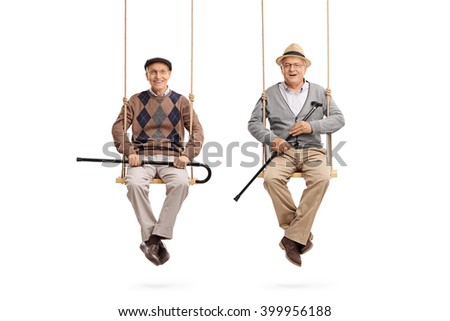 Two old friends sitting on wooden swings and looking at the camera isolated on white background - stock photo