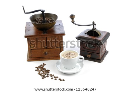 Two old grinders, cappuccino and coffee bean, isolated against a white background