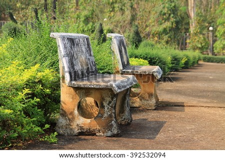 Two old marble benches in public park - stock photo