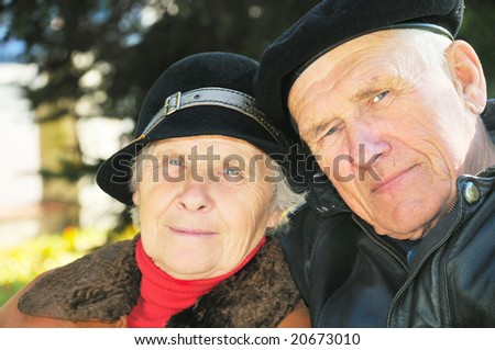 two old people on autumn background