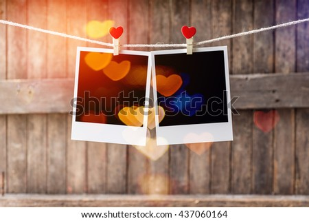 Two Old picture frame hanging on the clothesline,Selective focus,Clipping path for insert Photo - stock photo