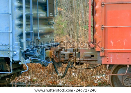 Two old retired freight cars coupled together - stock photo