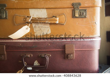 Two old retro suitcase with tags