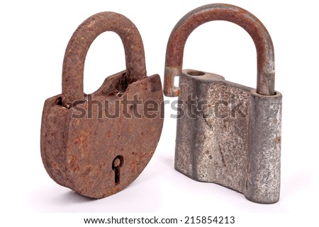 Two old rusty padlocks isolated on white background