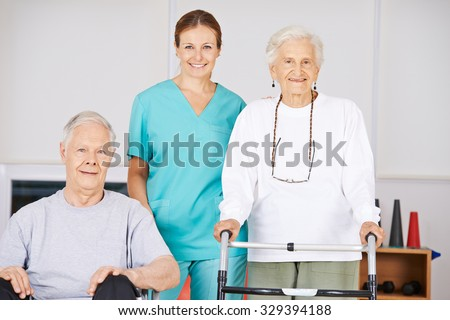 Two old senior people in nursing home with a geriatric nurse - stock photo