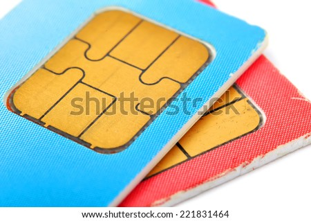 two old sim cards isolated on white background - stock photo