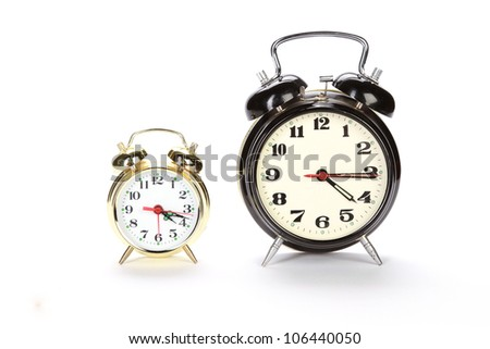 two old style alarm clocks isolated on white