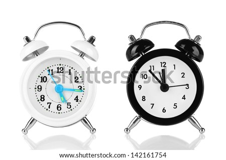 Two old style alarm clocks isolated on white - stock photo