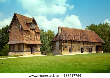 Two old styled houses in Normandy, France - stock photo