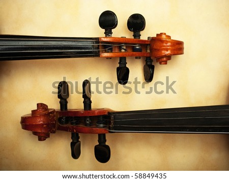 two old violin detail in ambient light - stock photo