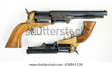 Two old western six shooter cowboy pistols. - stock photo