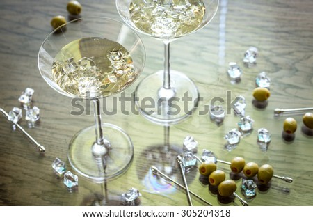 Two olive martini cocktails - stock photo