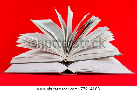 Two open books on red background