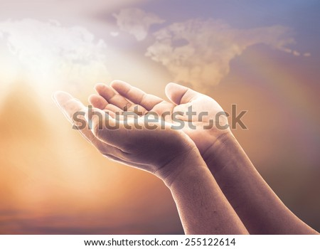 Two open empty hands with palms up, over blurred world map of clouds with amazing autumn light background. Pray for support, Help, Business, World Environment Day, Jesus Christ praying, Grace concept. - stock photo