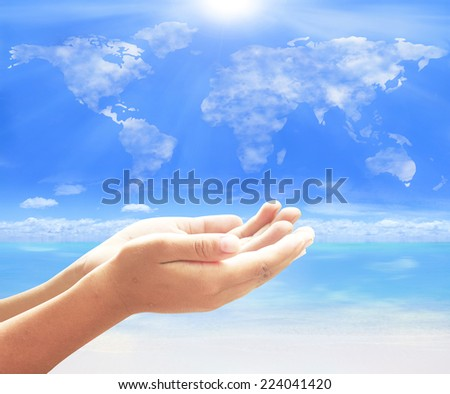 Two open empty hands with palms up, over world map of cloud with sea view background. Investment, Saving, Synergies, Ecology, World Environment Day, CSR, Mission, Ecosystem, Health Care, Pray concept. - stock photo