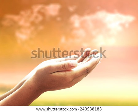 Two open empty hands with palms up, over world map of clouds background.