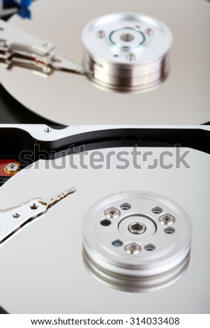 Two open hard disc drive macro photo - stock photo