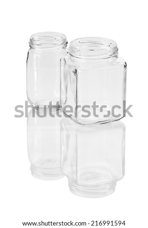 Two opened empty glass jars. Isolated on a white background.
