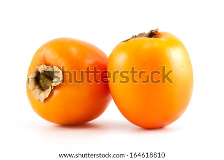 Two orange fresh organic persimmon on white background