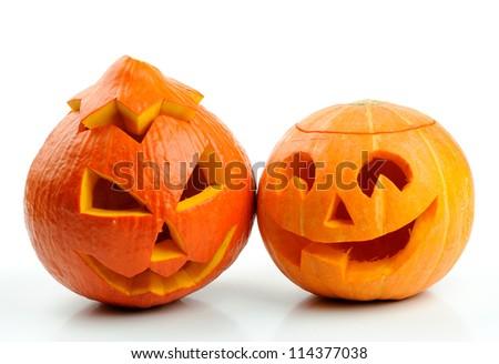 Two orange halloween pumpkins Jack O Lanterns isolated on white background - stock photo