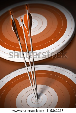 two orange targets in a row, three arrows hits the first one in the center, vertical background - stock photo