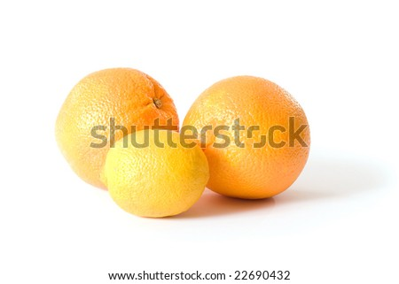 two oranges and a lemon isolated on a white background.