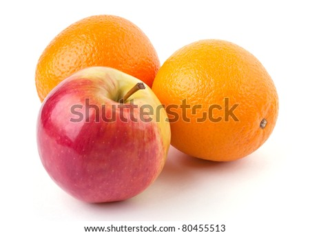 Two oranges and juicy apple isolated on white background - stock photo