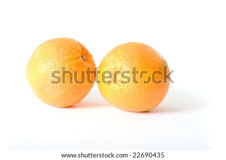 Two oranges isolated on a white background.
