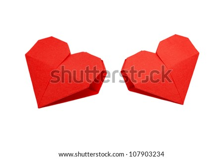 Two origami hearts. Symbol of Valentine's Day, love and happiness. Can be used as a greeting card. Ready for your logo. Isolated on white background with clipping path - stock photo