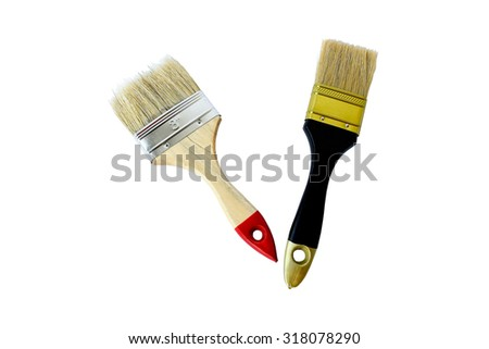 Two paint brushes isolated on white.