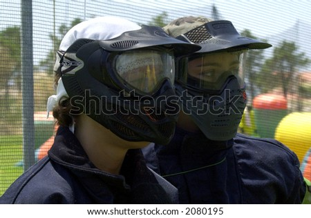two paintball girl players watching