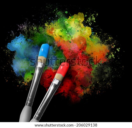 Two paintbrushes are painting a rainbow splattered art project. The brushstrokes are messy on a black isolated background. - stock photo