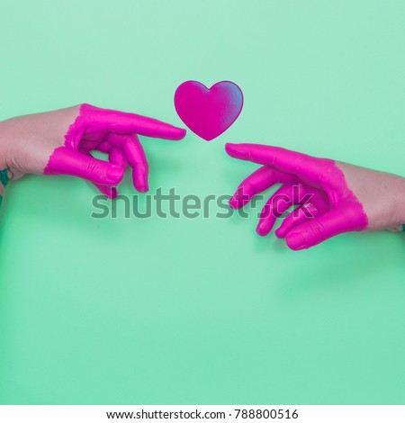 Two Painted Hands Touch Heart ...