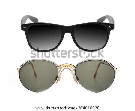 Two pair of fashionable sunglasses. Isolated on a white background.