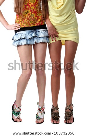 Two pairs female sexy legs on a floor, white background - stock photo