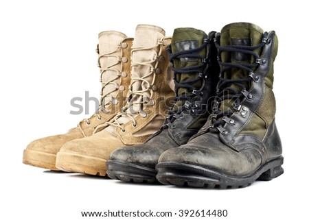 two pairs of army boots isolated on white background - stock photo