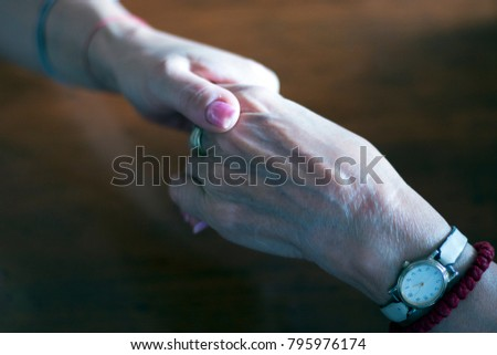 two pairs of hand touching each other, together, helping hands