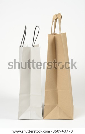 Two paper bags for shopping on white background