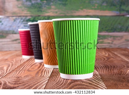 Two paper coffee cups on wood desk - stock photo