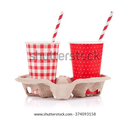 Two paper cups with takeaway drinks in holder. Isolated on white background - stock photo